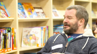 Parent champion speaking at a meeting in a library