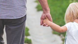 child walking holding hands with elder