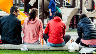 People hang out at child play area